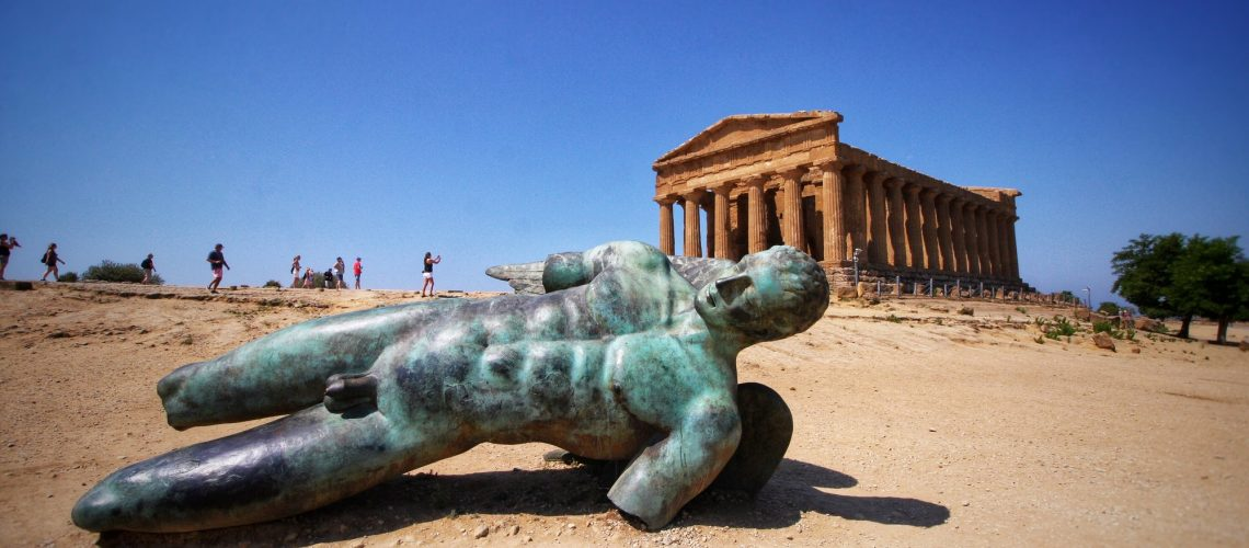 Statue of Icaro in front of a temple in valle dei templi Agrigento